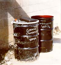 Drums of gasoline-contaminated water (19723 bytes)